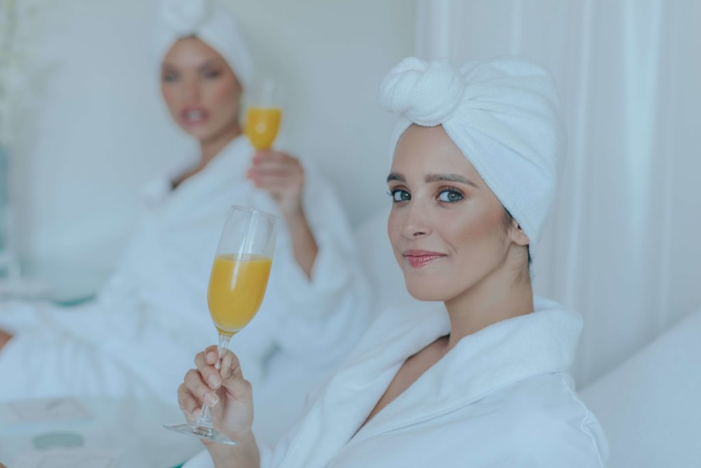 Two woman drinking mimosas