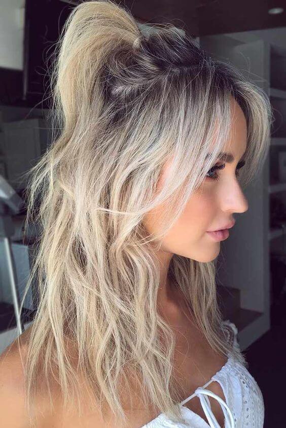 center part half up hairstyle