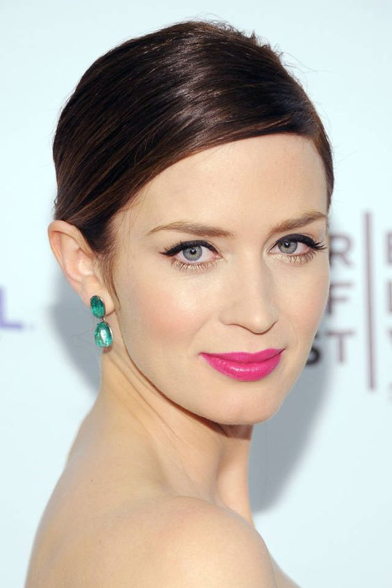 A pretty woman wearing a pink lipstick