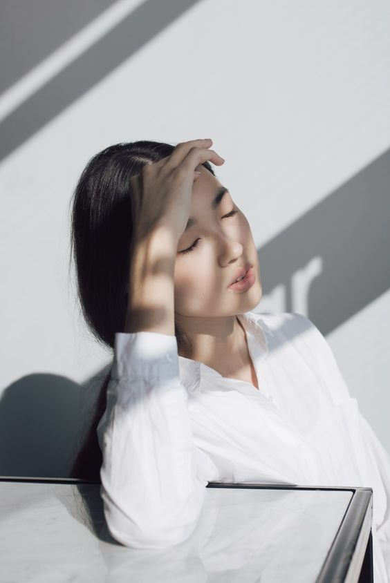 A woman image under the sun wearing sunscreen indoor
