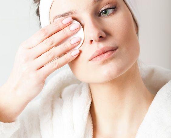 A girl removing here eyelash
