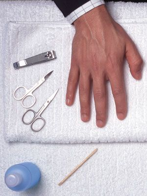 picture of a hand with nail cutter & nail scissors for men manicure