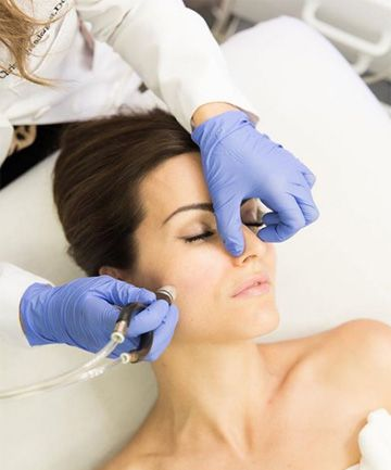 wearing medical glove for tri-lifting glow facial treatment