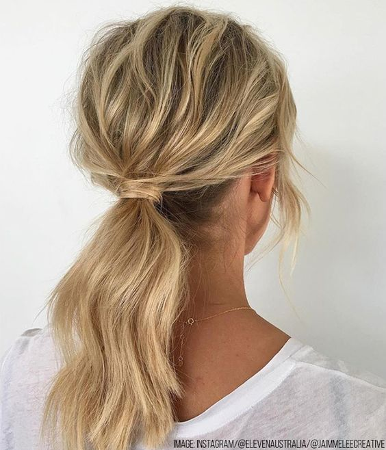 Wrap the hair around the top of the pony to conceal